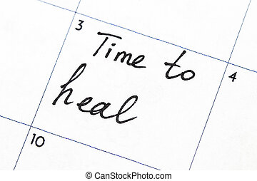 """""""time to heal"""" text write on calendar"""