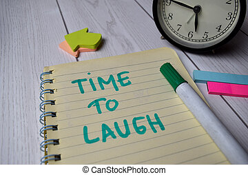 Time to Laugh write on a book isolated on Office Desk
