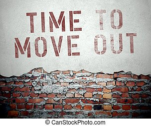 Time to move out concept on old brick wall