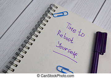 Time To Reboot Yourself write on a book isolated on office desk