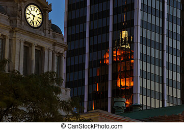 Allen County Court House in Fort Wayne, IN next to PNC Bank with Tower Bank (Lincoln Tower) reflecting in the glass.