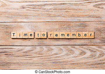 Time To Remember word written on wood block. Time To Remember text on wooden table for your desing, concept