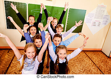 time to rest - Happy schoolchildren at a classroom. ...