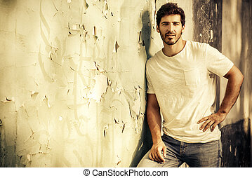 time to rest - Portrait of a handsome young man in jeans and...