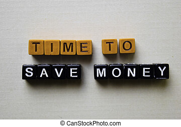 Time to Save Money on wooden blocks. Business and inspiration concept