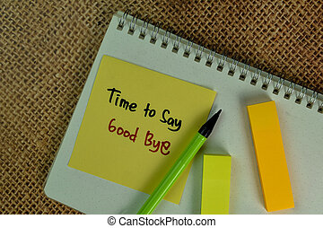 Time to Say Good Bye write on sticky notes isolated on Wooden Table.