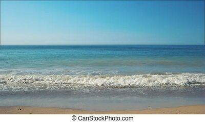 Time to sunbathe and swim. Small wave on the sea. Sand and...