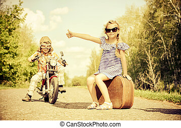 time to travel - Happy kids go on a journey on a motorcycle...