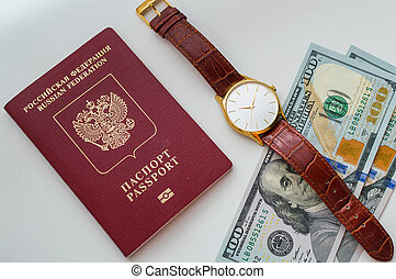 Time to travel. Two banknotes of 100 american dollars each, Russian passport on a white background