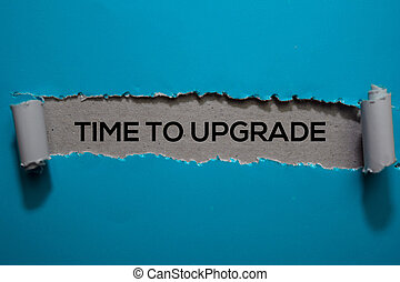 Time To Upgrade Text written in torn paper