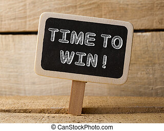 Time to win. Business Concept. text write on Chalkboard at wooden background