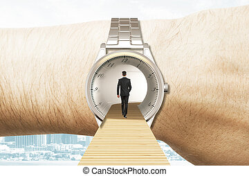 Time travel concept with businessman walking into the watches on the hand