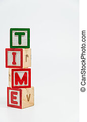 TIME word wooden block arrange in vertical style on white background and selective focus