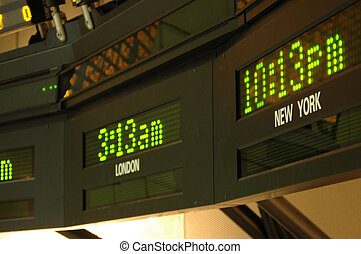 Time Zones - Clocks displaying the times in New York and...
