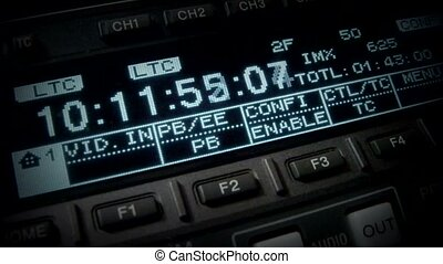 Timecode (rewind). Editor works with the television...