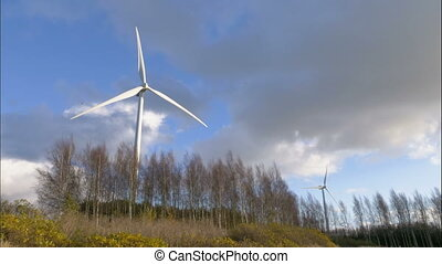 Timel apse of wind turbines turning. Windmill