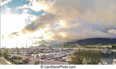 Timelaps golden sunny sunset at yacht marine