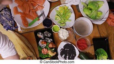 Timelaps of making sushi - Timelapse of preparing sushi in...