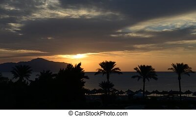 Timelaps of sunrice and beach with a view on Tiran island at...