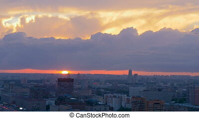 Timelapse. A beautiful sunset over Moscow. Large clouds swim over the city.