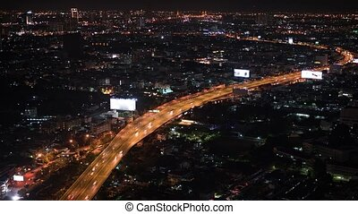 Timelapse Abstract of Bangkok's Night Time Cityscape with Traffic