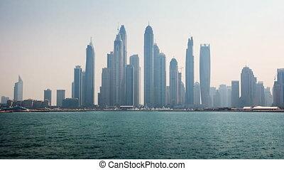 Timelapse Abstract of the Dubai Skyline over the Harbor