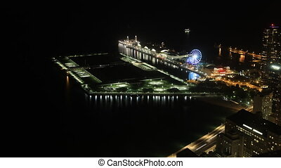 Timelapse aerial of Navy Pier, Chicago at night - A...
