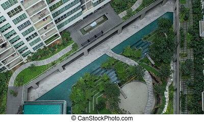 Timelapse aerial shot of landscape area outside apartment blocks