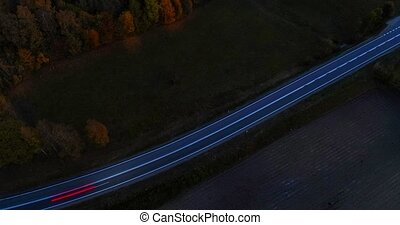 Timelapse aerial video of evening country road.
