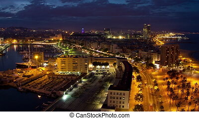 Timelapse at night of barcelona skyline - Time lapse footage...