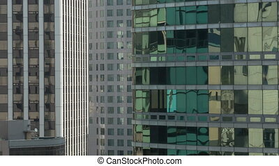 Timelapse close up view of part of skyscrapers, mirror rank...