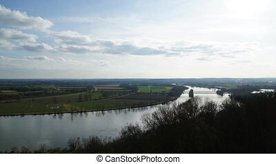 Timelapse clouds over the field and the danube river in full HD