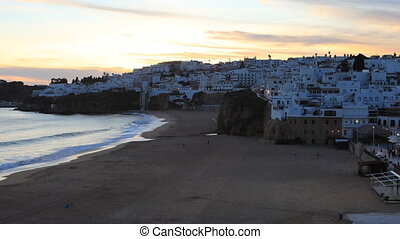 Timelapse day to night of beach at Albufeira, Portugal from clifftop