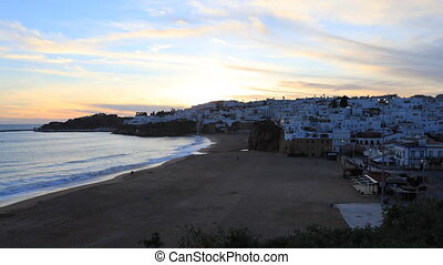 Timelapse day to night of beach at Albufeira, Portugal