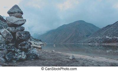 Timelapse Dolly Shot of Mountain Lake on Manaslu Trek -...