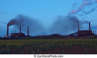 Timelapse factory smoke stacks billow, thick smoke. -...
