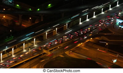 Timelapse: fast moving cars traffic and warm street light at night