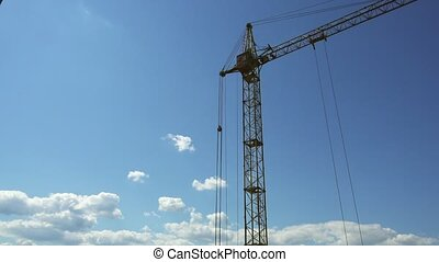 Timelapse footage of a construction crane, blue sky -...