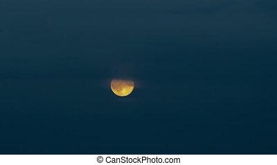 Timelapse full moon over late eveni