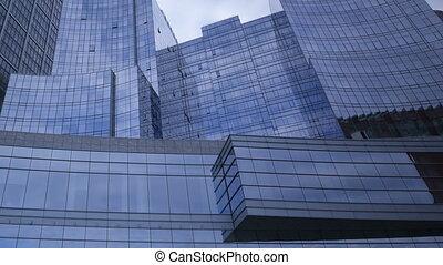 Timelapse glass skyscraper tiltshot