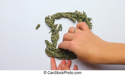 Timelapse. Hands make letter D of the English alphabet of marijuana