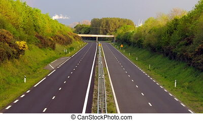 Timelapse - Highway at dusk - Timelapse - Zooming out on a...