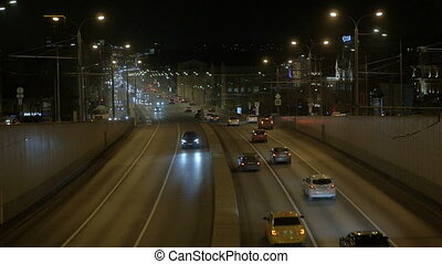Timelapse. Intensive traffic in the evening. View from...