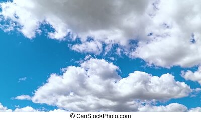 Timelapse movement of clouds in the blue sky