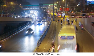 Timelapse. Night road in the city of lights cars traffic in Hanoi. Vietnam.
