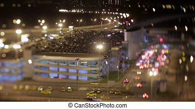 Timelapse night shot of car traffic near parking lot
