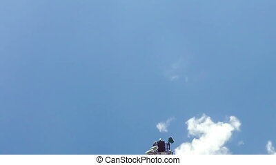 TimeLapse of a cloudy daytime sky with a GSM base station,...