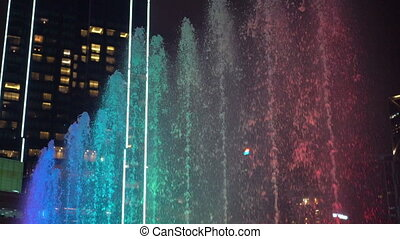 Timelapse of a colourful musical dancing fountains.