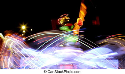timelapse of a fast ride carnival in barcelona spain, making light trails
