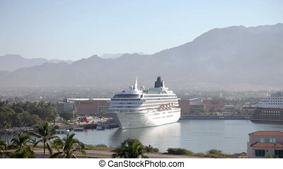 timelapse of a large cruise ship in the harbour in puerto vallarta, mexico